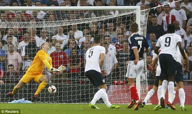 Blunder: Hart was at fault against Scotland when James Morrison's shot went straight through him