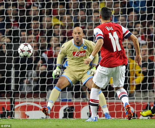 Beaten: Reina attempts to get near a stunning Mesut Ozil shot during Arsenal's win over Napoli