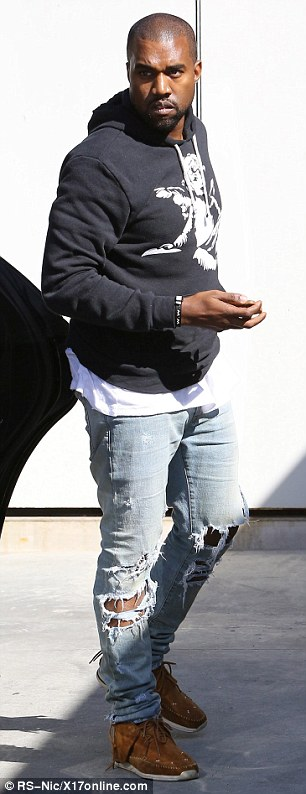 Scruffy much? Kanye wore ripped jeans, a black hoodie and moccasins for his radio interview