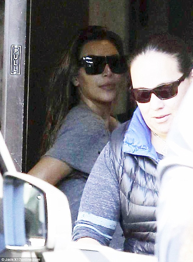 Laying low: Kim was pictured filming with wet hair and little makeup on Monday in LA