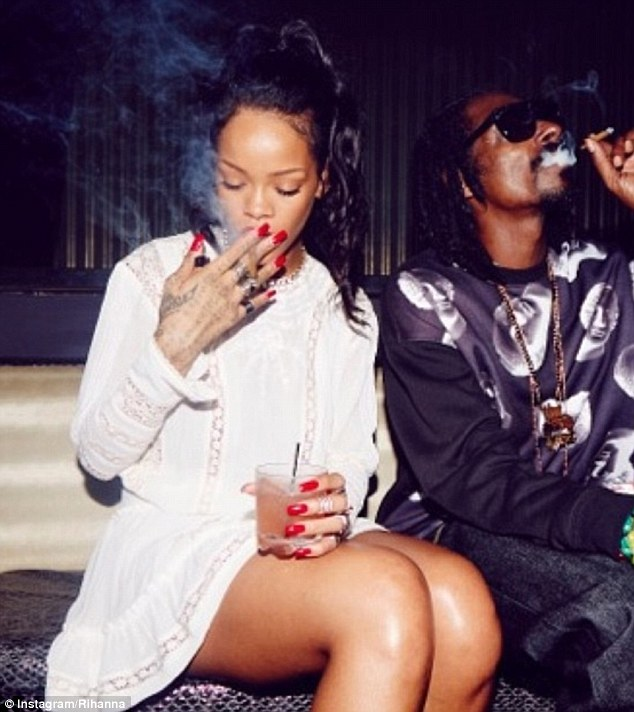 'Chiefin wit a chief!' Rihanna and Snoop Dogg spark up together in an Instagram picture posted by the star
