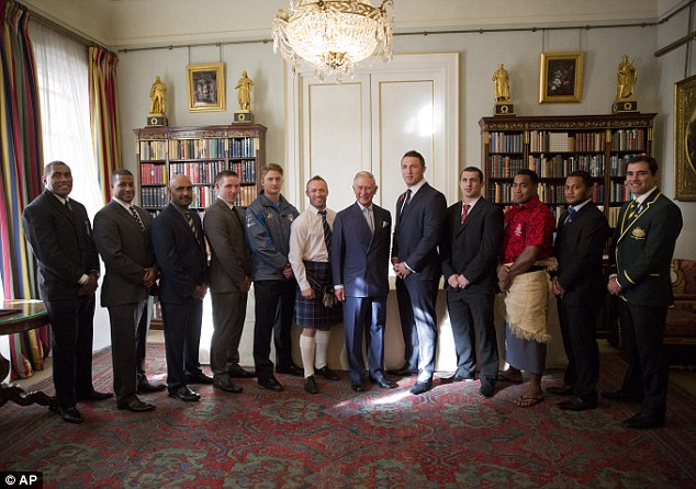 Meet and greet: Prince Charles (middle) poses with players and representatives of teams competing at the Rugby League World Cup