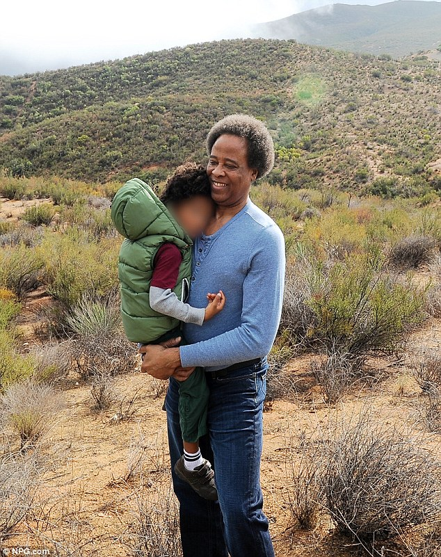 Reunion: Conrad Murray with his son Che Giovanni on Monday, shortly after his release from jail