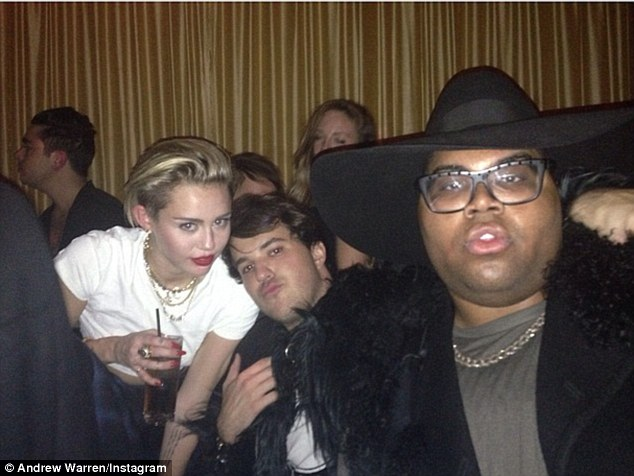 Tut tut: Underage Miley Cyrus parties with pals Andrew Warren and E.J. Johnson at 1 Oak nighclub in New York