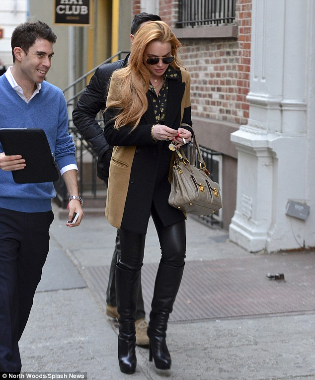 Owning it: The actress fiddles with her keys as she walks through Soho with a friend