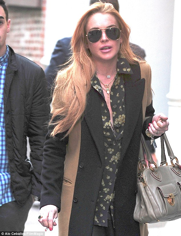 City slicker: Lindsay Lohan looks amazing as she pounds the streets of New York in a gorgeous outfit, but her rumoured party pal, Miley Cyrus is nowhere in sight