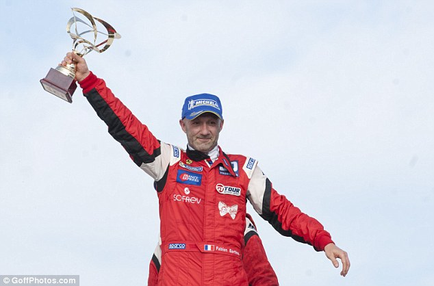 King of the crop: Barthez holds aloft the France GT Championship at the Paul Ricard circuit