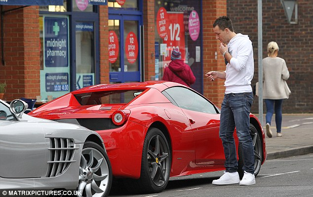 In good company: Footballers John Terry (above) and Jack Wilshere (below) drive their Ferrari 458s