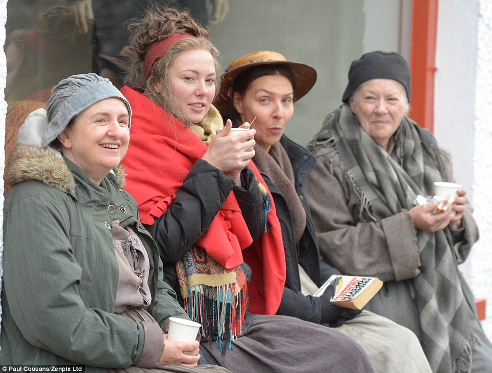 Taking a break: Some actors on the set of Jamaica Inn take a breather as filming continues. The drama will be shown in three sixty-minute episodes next year