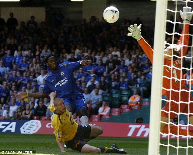 So it begins: Didier Drogba fires home past Jens Lehmann in the Community Shield