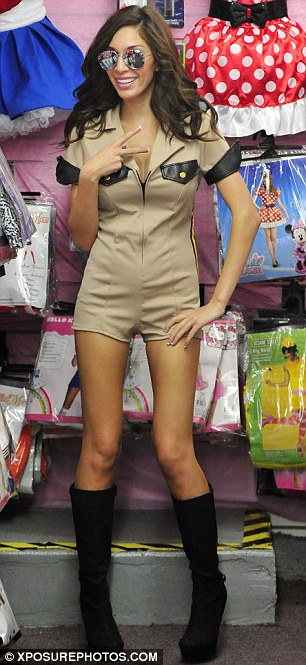 In the mix: Farrah enjoyed trying on the costumes in the fabled Hollywood store
