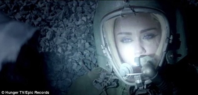 Alien territory: Miley Cyrus is seen wearing a space suit in a new teaser clip released Tuesday for Future's Real & True music video