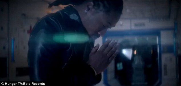 God help me: Future is seen holding his hands in prayer at one point in the 33-second clip