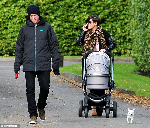 Baby onboard: Frankie and Reading left-back Wayne were giving newborn son Parker his very first outing