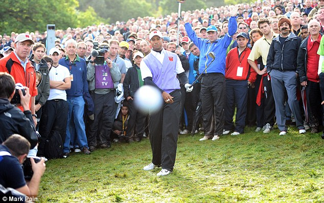 The Mail on Sunday's Mark Pain found himself in the line of fire at the 2010 Ryder Cup at Celtic Manor as Tiger Woods duffed his chip... but check out 'Cigar Guy' towards the right of the photo
