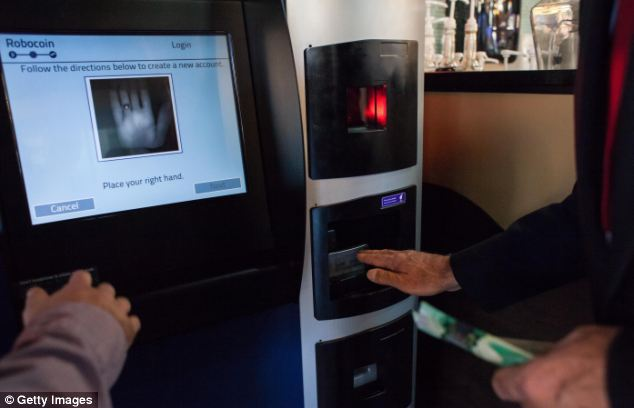 A user is instructed on how to scan his palm using scanning identification to ensure that a single user cannot exchange more than $1,000 in a single day