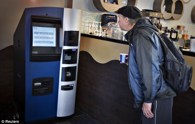 A man looks at the world's first ever permanent bitcoin ATM