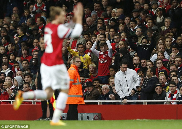In the Nik of time: Bendtner is hooked by Wenger to the delight of the Arsenal supporters
