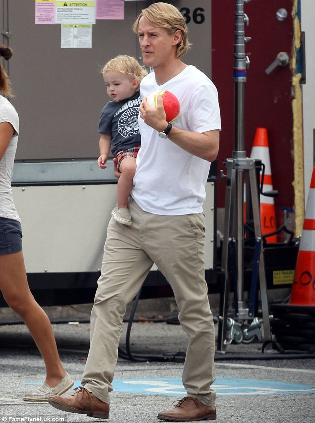 Daddy duty again: Owen is already a father to Robert, now two, who he is pictured with last year