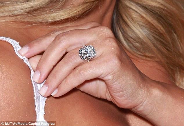 Million dollar ring: Kim Kardashian, on her third engagement, shows off the lavish diamond bought by Kanye West