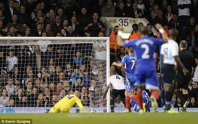 Shocker: Friedel directed the ball into his own net and Davies celebrated as the Tigers drew level (below)
