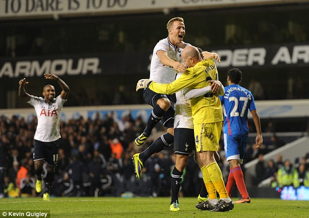 Paying the penalty: Friedel saved Elmohamady's spot kick (below) and is mobbed by his team-mates