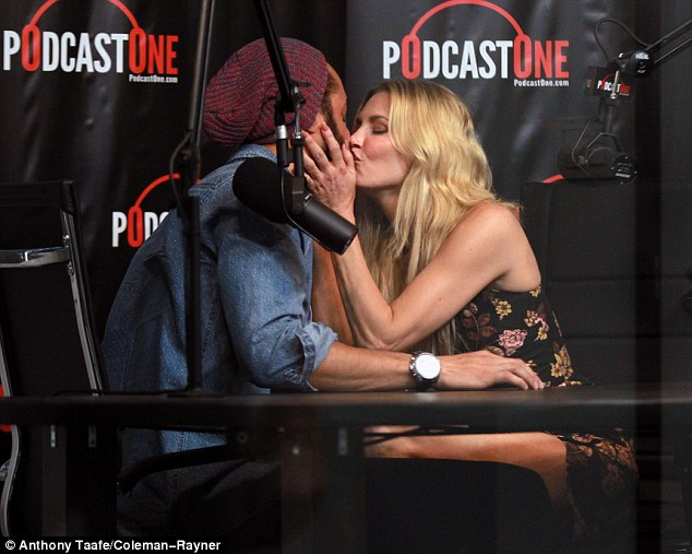 Sealed with a kiss: The couple kissed for the cameras