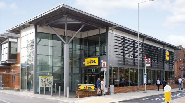 Tempting: Lidl is making a concerted effort to attract middle and higher income shoppers by introducing luxury products at low prices at its stores, including this branch in Leatherhead, Surrey