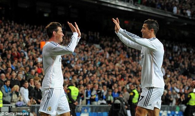 Duo: Gareth Bale and Cristiano Ronaldo high five during Real Madrid's 7-3 win over Sevilla