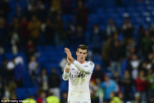 Appreciation: Bale applauds the fans at the Bernabeu after Madrid's 7-3 victory