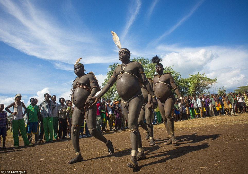 Competition: On the day of the Ka'el ceremony, the tribe's fat men walk for hours around a sacred tree, watched by other men and helped out by the women