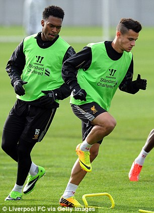 Ready for action: Coutinho steps up the pace and hotshot strike partners Sturridge and Suarez share a joke