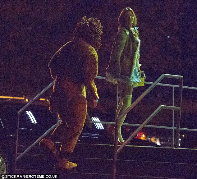Off to see the Wizard: Gisele and her husband Tom Brady attended a Halloween party on Monday night in Boston dressed as Dorothy and the cowardly lion from The Wizard Of Oz