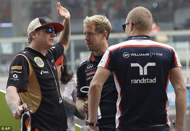 Still waiting: Kimi Raikkonen (left) is prepared to go on strike unless Lotus pay him the wages he is due