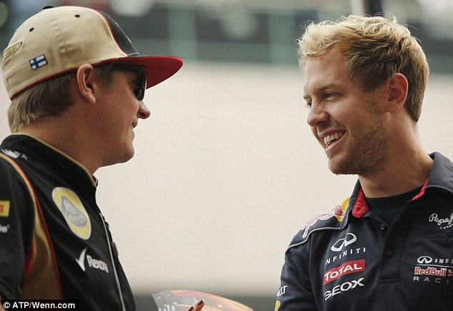 Arrival: Raikkonen, pictured talking to Sebastian Vettel, turned up a day late in Abu Dhabi ahead of the Grand Prix