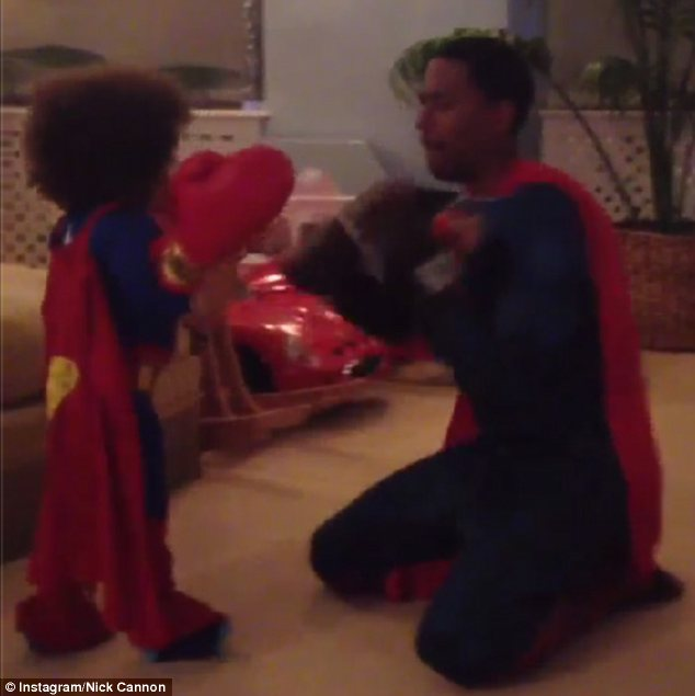 Battle of the superheroes: Nick Cannon and Moroccan battled it out in their identical outfits