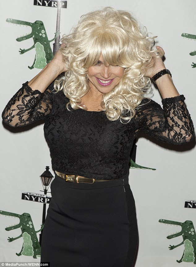 Bombshell: The 56-year-old news anchor looked to be channelling Dolly Parton for Halloween