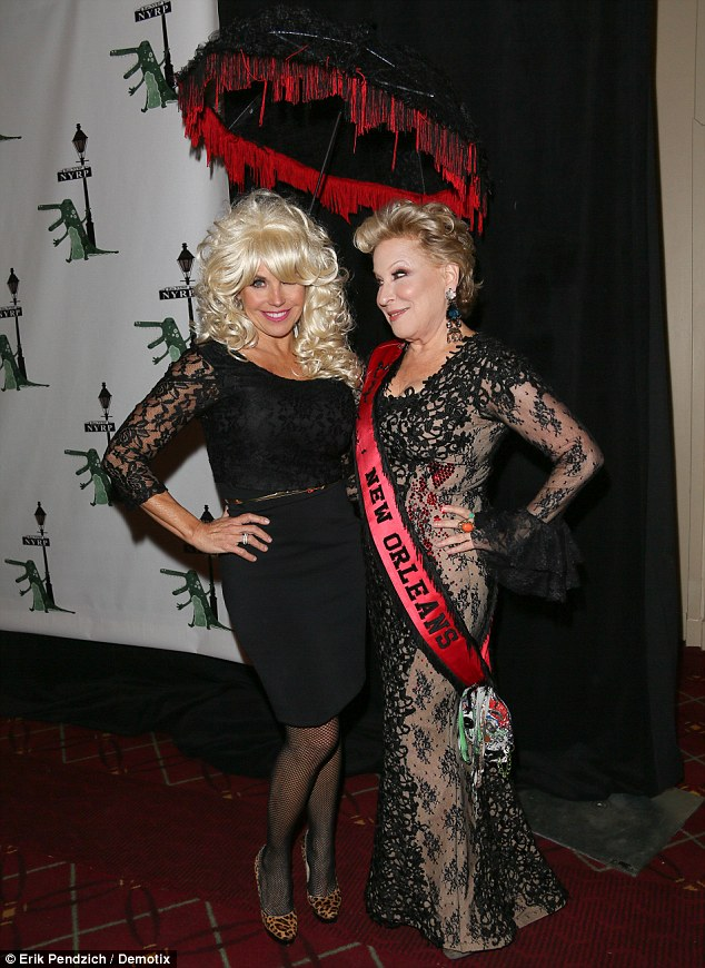 Quite the duo: Katie Couric and Bette Midler at The 18th Annual 'Hulaween In The Big Easy' Event in New York, on Thursday