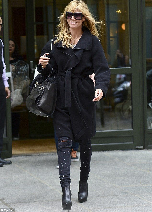 Early bird special: Heidi Klum emerges from her hotel room in New York after dressing up as an old lady for Halloween