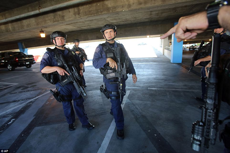 Armed response: The LA Police Department is taking the lead on the investigation but SWAT teams were a major presence in the area as the terminal was being searched after the shooting
