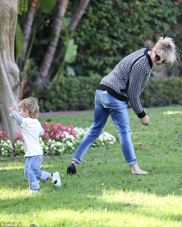 Fun times: The mother and son played around on the grass during their outdoor excursion