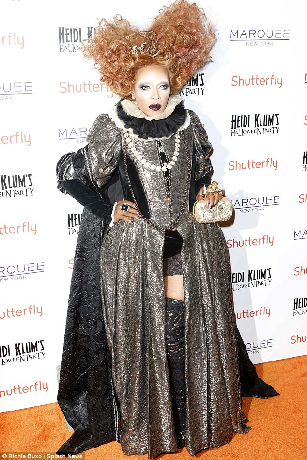 Reigning supreme: Celebrity stylist looked suitably royal, revealing a flash of thigh in a sexy take on an outfit Elizabeth I could never have worn
