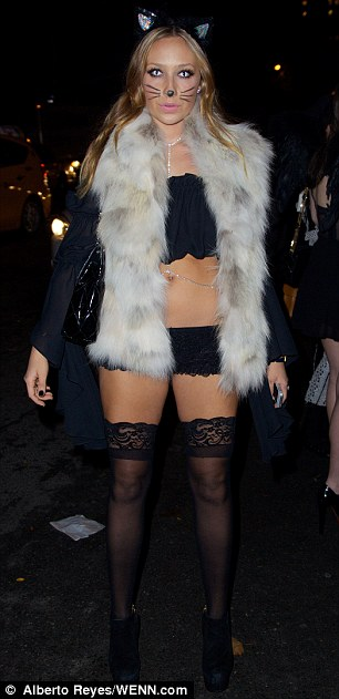 Tale of two costumes: Partygoers Cory Kennedy and Gaia Matisse opted for tamer looks in comparison to Heidi