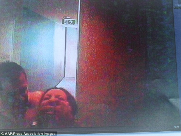 Fatal struggle: Caught on security TV Gittany grabbed Lisa Harnum around the neck just over a minute before she plunged to her death from their apartment balcony
