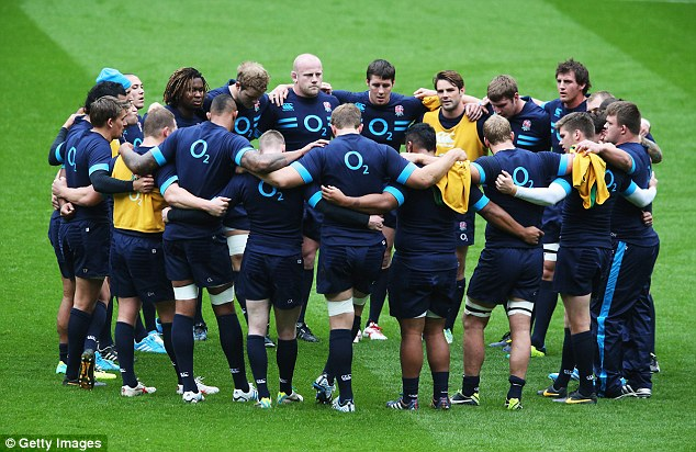 Talking tactics: England's players huddle around captain Robshaw (third right) for a briefing