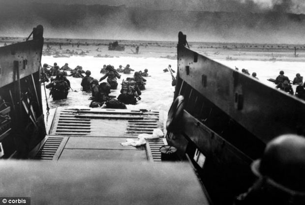 Attack: American soldiers landing on the coast of France in the Normandy landings June 6th 1944 - a year after the successful 'Operation Mincemeat' mission