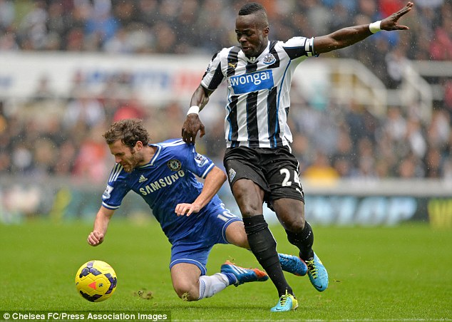 Outmuscled: Cheick Tiote bundles Juan Mata off the ball