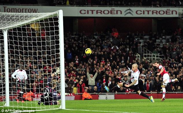 Still on top: Santi Cazorla )right) scores Arsenal's winning goal against Liverpool last Saturday