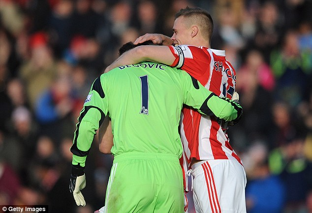 How about that? Begovic is congratulated by team-mate Ryan Shawcross after scoring from his own area