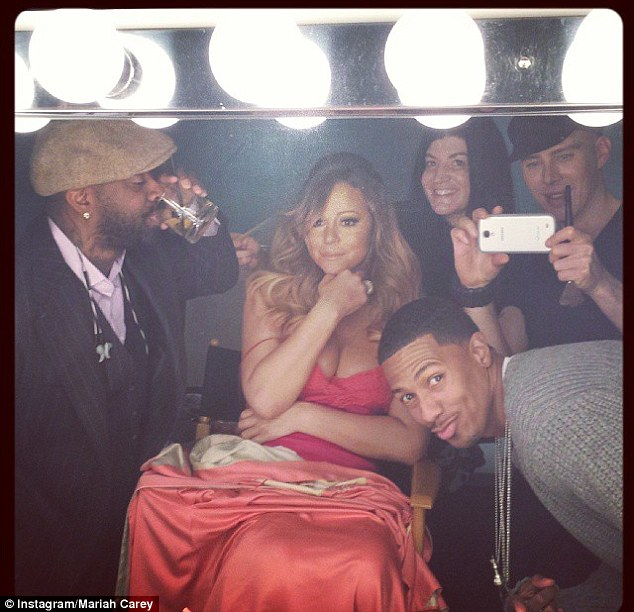 Ready for your close-up? Mariah is surrounded by people in the glamorous 'selfie' shot